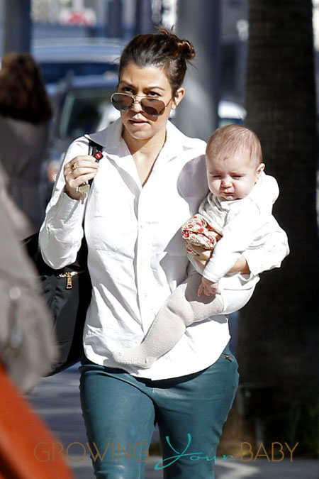 Kourtney Kardashian carries her baby daughter Penelope while shopping in Beverly Hills