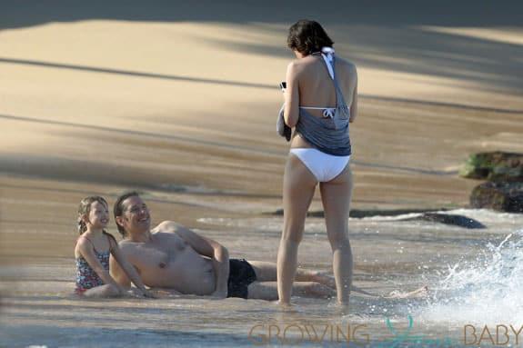 Milla Jovovich spotted on the beach in a bikini on New Years Eve in Maui, Hawaii.