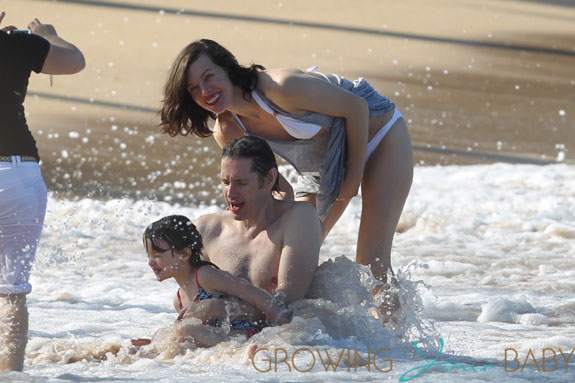 Milla Jovovich spotted on the beach in a bikini on New Years Eve in Maui, Hawaii.