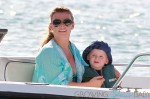 A pregnant Coleen Rooney, wife of Manchester United star Wayne Rooney, takes her son Kai out for some fun in the sun and sand in Barbados