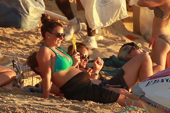 Coleen Rooney enjoys the sunset with her son Kai and other family members, while on holiday in Barbados