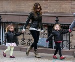 Actress Sarah Jessica Parker forms a train with her twin daughters, Marion and Tabitha Broderick, as they walk to school in West Village in New York City