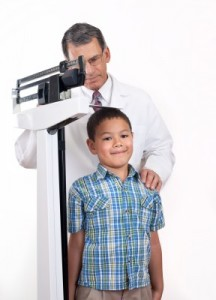 doctor measuring boy