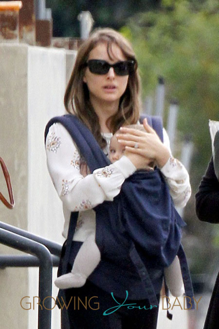 Natalie Portman carries her son Aleph in a Baby Bjorn carrier as she and fiance Benjamin Millepied are spotted out and about in Santa Monica