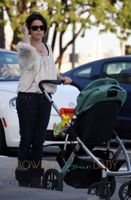 **EXCLUSIVE** Neve Campbell heads out for a walk and sings to her son Caspian in Los Angeles