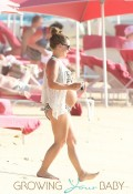 Coleen Rooney enjoys a day at the beach with son Kai and her parents