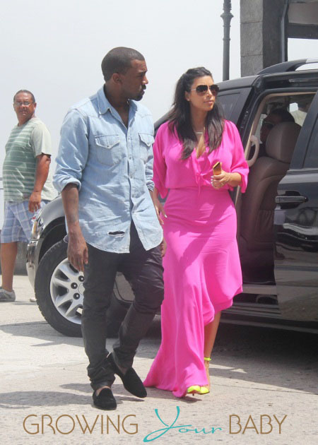 Pregnant Reality Tv Star Kim Kardashian Wears A Pink Dress