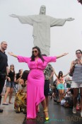 Pregnant reality TV star Kim Kardashian wears a pink dress while her and boyfriend rapper Kanye West visit the Christ the Redeemer statue in Rio De Janeiro