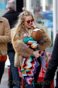 Sienna Miller takes her baby daughter Marlowe for a stroll around Soho in New York City