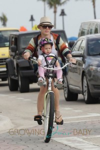 Pink and her husband Carey Hart take their daughter Willow for a bicycle ride in Fort Lauderdale, FL