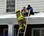 Neighbors Keep Baby on the Roof Safe While Awaiting the Help of Emergency Responders