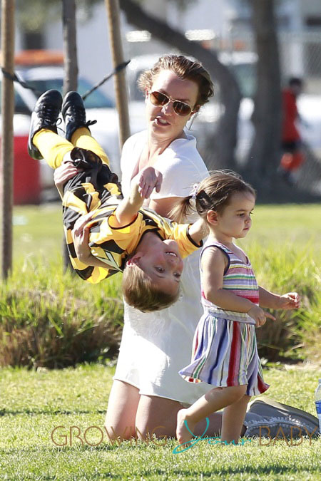 Britney Spears watches her sons Sean Preston and Jayden James play soccer before changing into a new outfit inside a clothing store