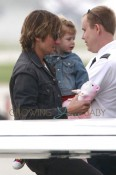 **EXCLUSIVE** Keith Urban and his daughters Sunday Rose and Faith Margaret are seen boarding a private plane at Van Nuys Airport in Los Angeles