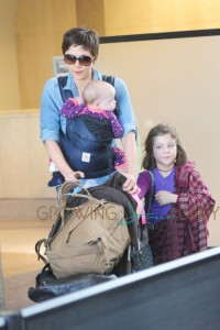 **EXCLUSIVE** Maggie Gyllenhaal has her hands full as she carts her kids and luggage through LAX in Los Angeles