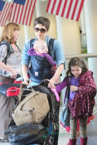 Maggie Gyllenhaal has her hands full as she carts her kids and luggage through LAX in Los Angeles