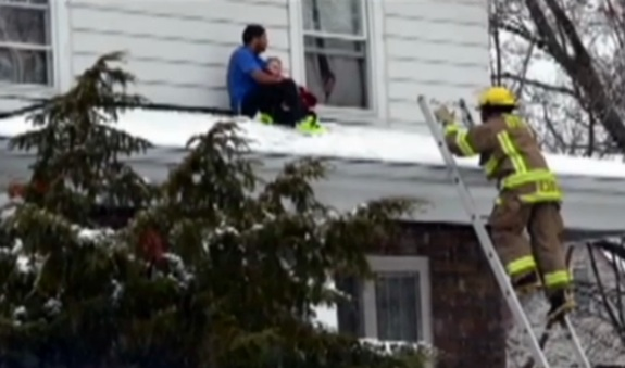 Niagara resident Antwan Moore rescues a toddler on roof