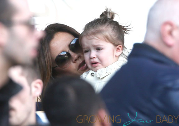 Victoria Beckham and family cheer for David Beckham in Paris