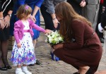 the duchess of cambridge accepts flowers from Lucy Bell