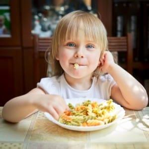 Little girl having a pasta dinner