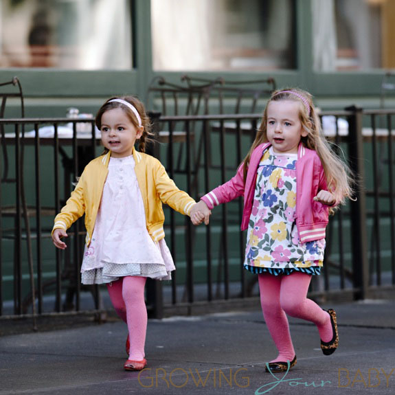 Sarah Jessica Parker's twin daughters Marion and Tabitha spotted wearing spring outfits while holding hands and running in NYC