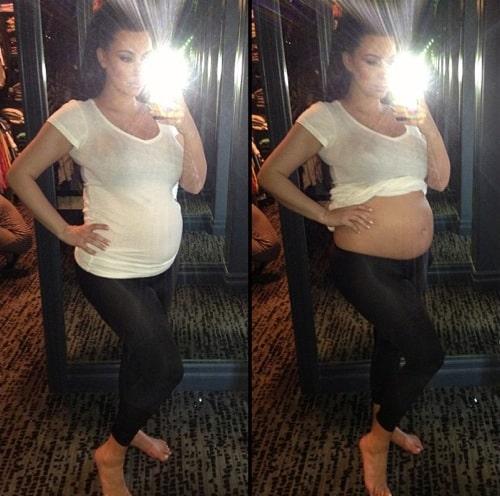 Pregnant Kim Kardashian bares her bump!