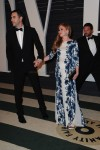 A very pregnant Isla Fisher & husband Sacha Baron Cohen at the 2015 Vanity Fair Oscar Party