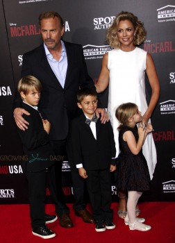 Kevin Costner and Christine Baumgartner with kids Grace Avery, Hayes and Cayden Costner at McFarland USA Premiere