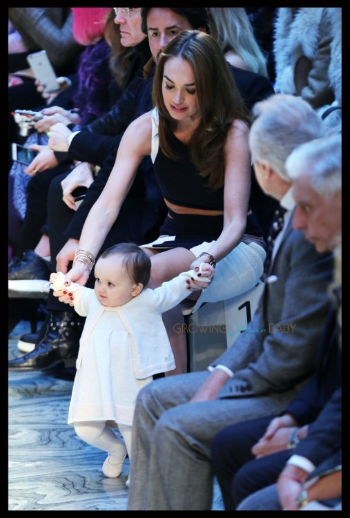 Tamara Ecclestone's baby tries to walk onto the catwalk at the Julien Macdonald show at London Fashion Week A/W 15-Day two