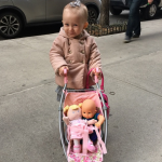 Carmen Baldwin pushing her Baby Anabelle stroller with baby dolls