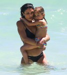 Bethenny Frankel and her daughter Bryn soak up the sun on the beach in Miami