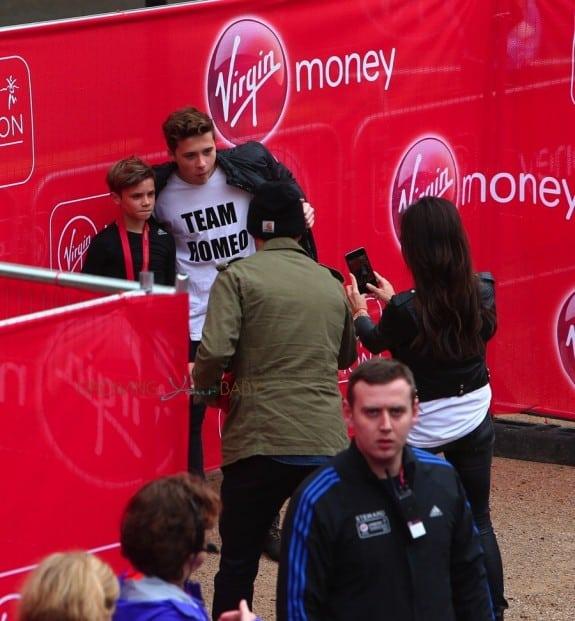 David and Victoria Beckham take their boy's picture at Romeo's mini London Marathon