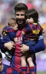 Gerard Pique with sons Milan and Sasha at FC Barcelona vs Valencia CF game in Barcelona