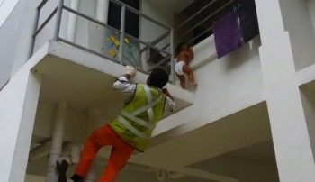 Road Workers Save Toddler Hanging From Balcony In Singapore