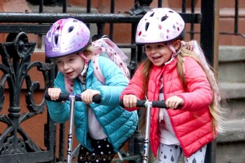 Tabitha and Marion Broderick scoot to school