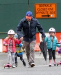 Tabitha and Marion Broderick scoot to school with their dad Matthew
