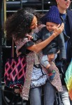 Thandie Newton is seen catching a cab with her son Booker in NYC