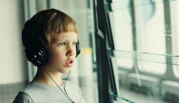 boy wearing headphones - autism