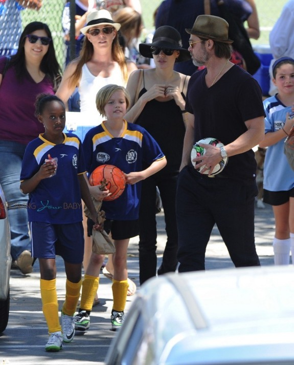 Brad Pitt and Angelina Jolie with daughters Zahara and Shiloh after a soccer game in LA