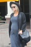 Ashlee Simpson shows her baby bump as she goes for juice with husband Evan Ross at Jamba Juice in Los Angeles