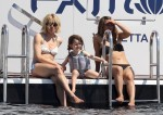 Sienna Miller on a yacht in Cannes, France with daughter Marlow Sturridge