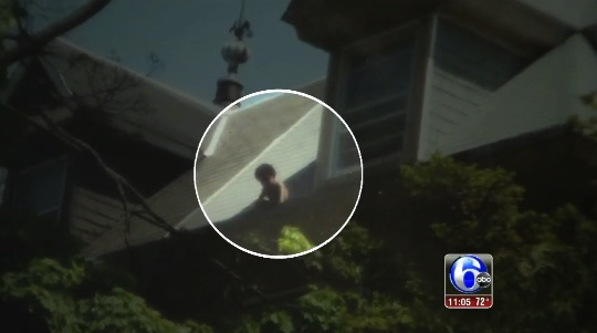Toddler rescued from roof