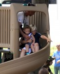 Zuma Rossdale rides the slide with his brother Apollo
