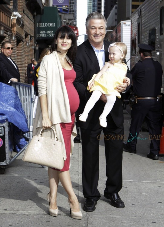 A very pregnant Hilaria Baldwin with husband Alec and daughter Carmen