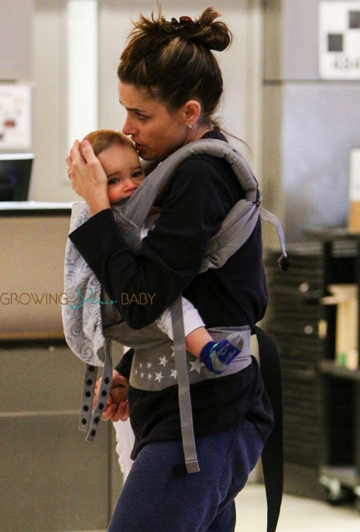 Amanda Peet at LAX with son Henry Benioff