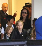 Angelina Jolie and Brad Pitt at LAX with their kids Shiloh, Vivienne and Pax