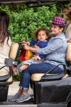 Camila Alves shuttles her  kids Vida and Livingston from a birthday party in a golf cart