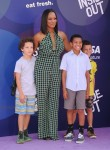 Garcelle Beauvais attends Inside Out Premiere with her sons Jax and Jaid
