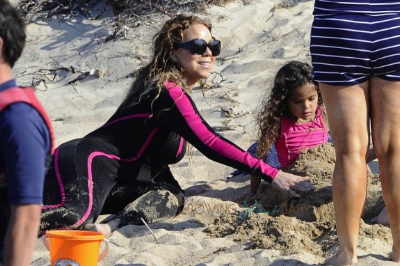 Mariah Carey at the beach with daughter Monroe in Sardinia