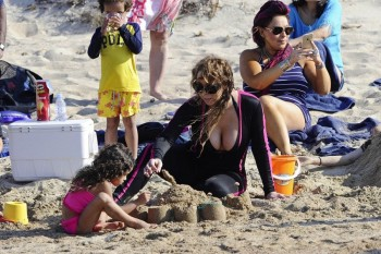 Mariah Carey at the beach with twins Moroccan and Monroe in Sardinia
