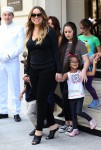 Mariah Carey exits her Paris Hotel with twins Moroccan and Monroe Cannon